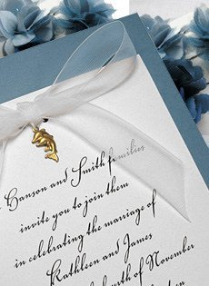 wedding invitations with charms and bow