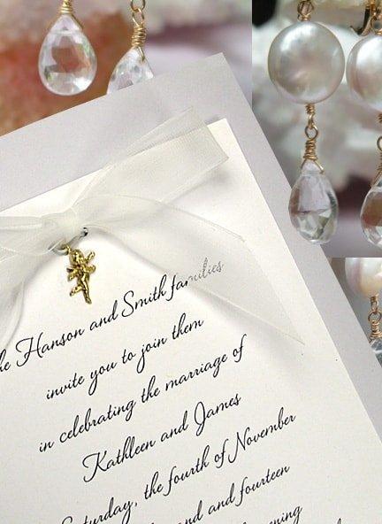 dusty blue wedding invitation with charm