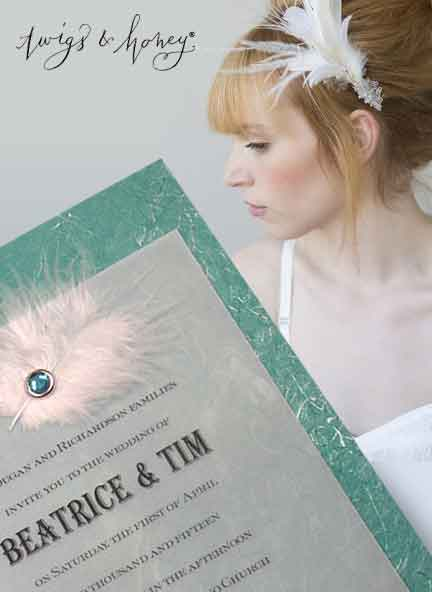 teal invitations with feather