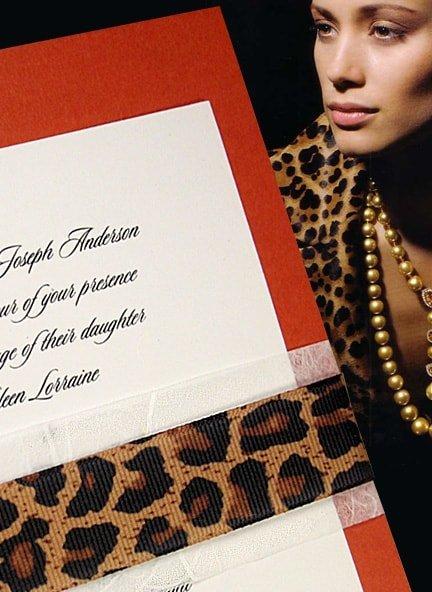 papaya orange invitations with animal print wrap