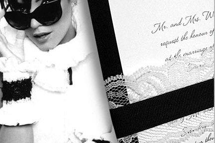 black invitation with lace wrap